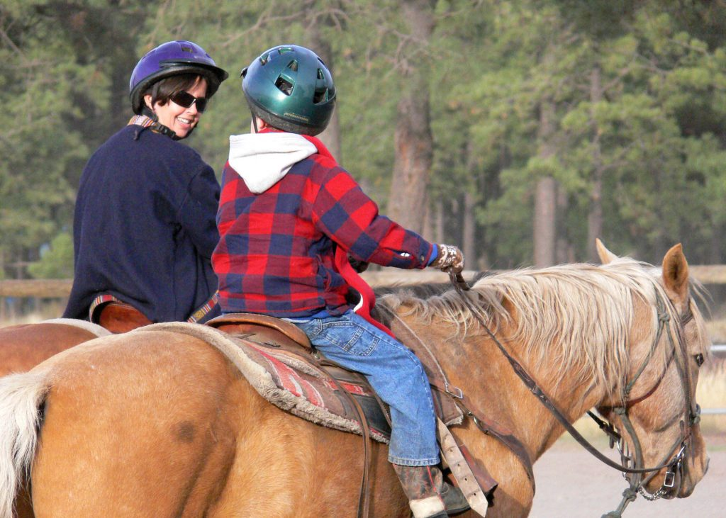 Carrie and Seamus riding horses at Hidden Meadows Ranch in Northern Arizona