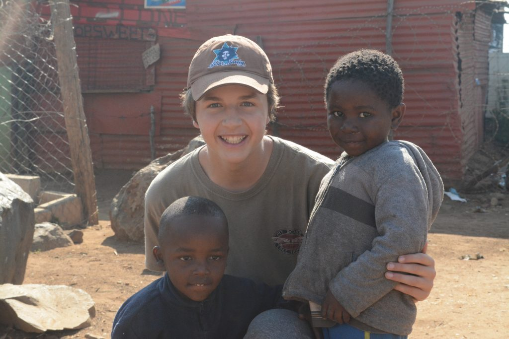 Nathan with kids in Soweto, South Africa