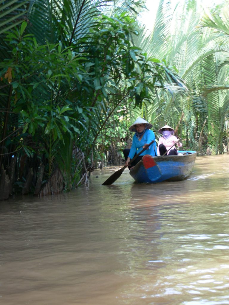 Local women in boat in Mekong Delta, Vietnam