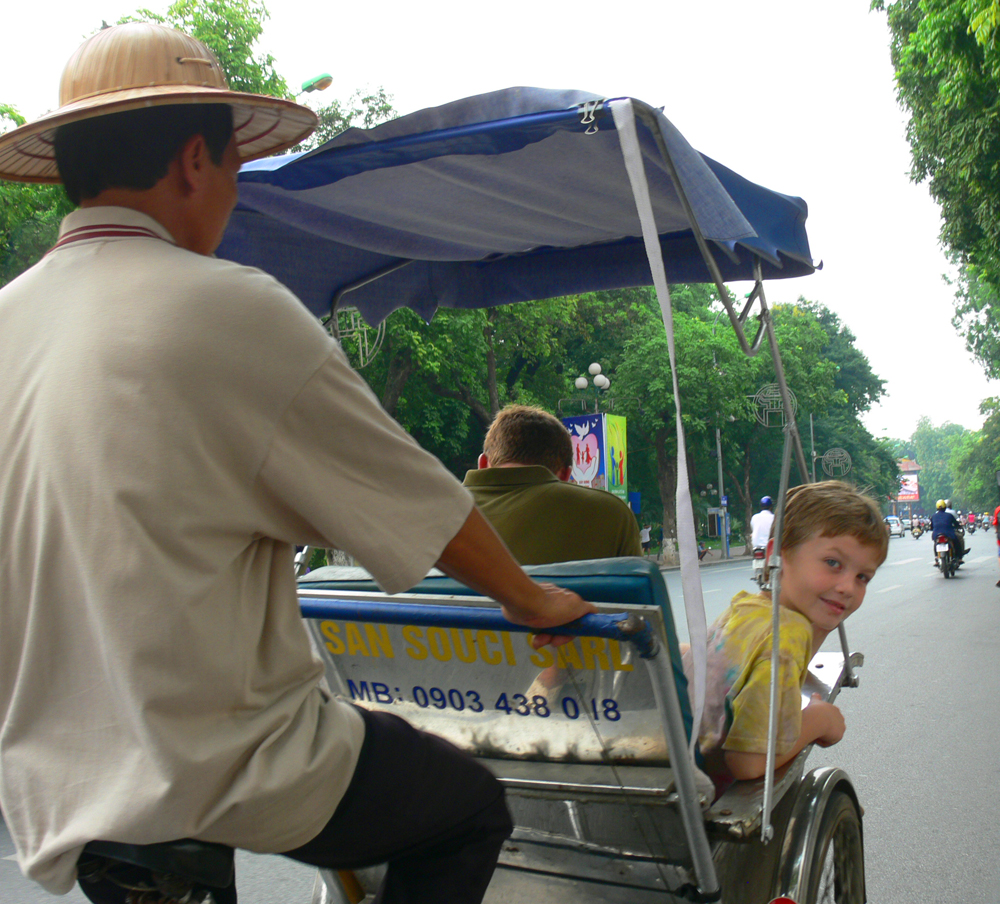 Seamus in rickshaw on family trip in Hanoi, Vietnam