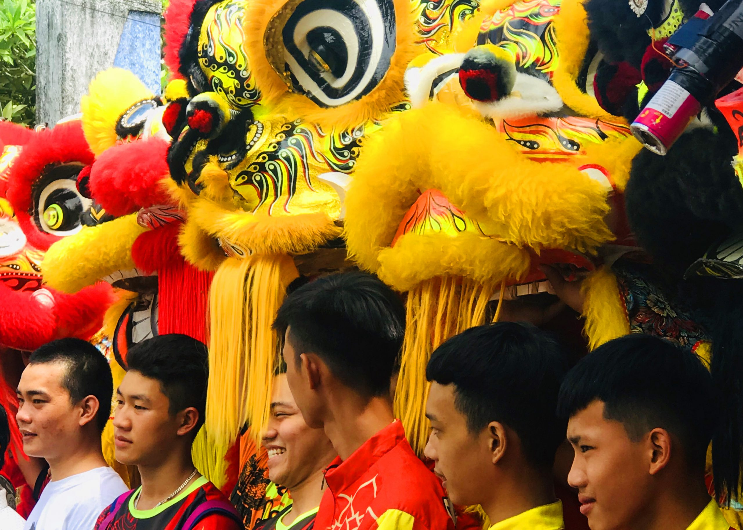 Boys with dragon masks, Hoi An, Vietnam